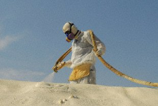 Butch Kline, foam team 1 leader, applies Terra Strong spray foam on the roof of a Contingency Operating Base Basra Medical Center tent, Oct. 17.