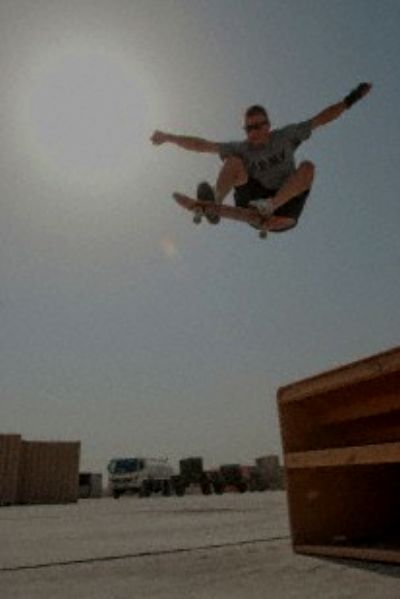 Sgt. Gregory Opoien, a Bloomington, Minn., native and an information assurance officer with the 34th Red Bull Infantry Division, ollies, or jumps off of a ramp, in a parking lot, Oct. 13, in Contingency Operating Base Basra. J.P. Lawrence