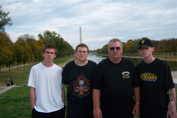 Army Spc. Kevin Hardin, far right, poses with his father, Charles, right, and brothers Kyle, left, and Keith, far left, in Washington, D.C. Courtesy photo
