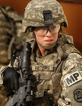 Sgt. Jennifer Peters, 186th Military Police Company, Iowa National Guard, provides security during military operations in urban terrain, or MOUT, as part of mobilization training.