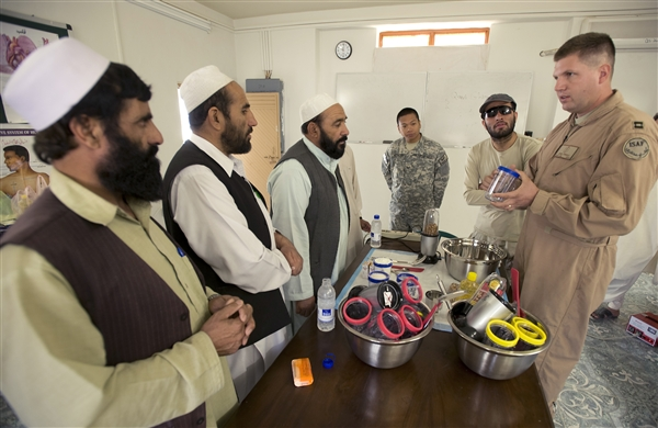Air Force Capt. (Dr.) James Arnold shows medical professionals from Afghanistan's Zabul province how to make
