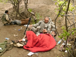 Army Reserve Spec. Gregory S. Ruske attends to an injured Afghan National Police officer who was wounded in combat in the Afghanya Valley, Kapisa Province, Afghanistan on April 21, 2008. Ruske was awarded the Silver Star, the third-highest medal for valor for his actions during the battle.