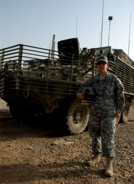 Spc. Tiffany Knotts stands next to her Stryker vehicle Oct. 13 at Camp Taji, northwest of Baghdad. Knotts is reportedly the first woman Stryker driver in the Army. Photo by Sgt. 1st Class Christina Bhatti