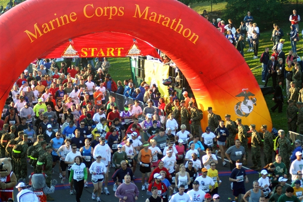 Some of the 18,281 participants in the 33rd Marine Corps Marathon cross the starting line Oct. 26, 2008. The marathon, which began in Arlington, Va., will have ripple effects around the world, as many runners participated to raise funds for troop-support groups. Photo courtesy of Tragedy Assistance Program for Survivors