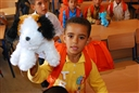 An Iraqi boy holds up a stuffed animal that he received at the Beirut Elementary School in Hayy, Iraq, Oct. 9, 2008. U.S. Army photo by Sgt. 1st Class Joe Thompson