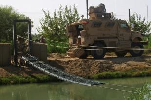 Marines from 2nd Platoon, Company C, 8th Engineer Support Battalion, Combat Logistics Regiment 2, Marine Expeditionary Brigade-Afghanistan, build a footbridge, Aug. 20, in Hasan Abad, Helmand province, Afghanistan. Since its completion, the 69-foot bridge has helped ease movement for both Marines and locals in the area.  Sgt. Garlen Powell