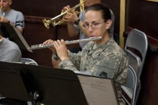 Staff Sgt. Katherine Fults, a flutist with 34th Red Bull Infantry Division Band, plays her instrument during a rehearsal at Contingency Operating Base Basra, Aug. 25. Fults, a resident of Burnsville, Minn., teaches third grade at Ascension School in Minneapolis. Sgt. Frank Vaughn