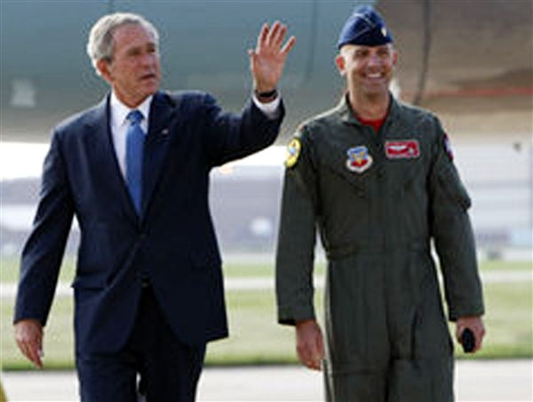 President George Bush talks with Air Force Maj. Dan Rooney of the Oklahoma Air National Guard after arriving at Tinker Air Force Base, Okla., Sept. 12, 2008. Bush presented Rooney with the President's Volunteer Service Award for his contributions to the lives of military families through his Folds of Honor Foundation. Rooney left for his third tour in Iraq shortly after receiving the award. Photo courtesy of the Folds of Honor Foundation