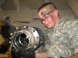 Army Pvt. Salim Jamal Srouji, of Norco, Calif., works on the rear axle of a vehicle in the motor pool on Forward Operating Base Kalsu, Iraq, Sept. 11, 2008. Srouji is a mechanic for the Automotive Maintenance Platoon of Company B, 703rd Brigade Support Battalion, 4th Brigade Combat Team, 3rd Infantry Division. U.S. Army photo by 2nd Lt. Anthony Asciutto