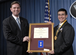 Principal Deputy Assistant Secretary of Defense for Public Affairs Robert T. Hastings, left, presents the certificate for the Office of the Secretary of Defense Medal for Exceptional Public Service to Joey Rizzolo, a seventh grader from Paramus, N.J., at the Pentagon, May 6, 2008. Rizzolo was awarded the medal for his support of Americas's servicemembers and his ASY Freedom Walk contributions. Defense Department photo by U.S. Navy Petty Officer 2nd Class Molly A. Burgess