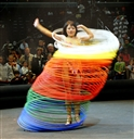 Taking on the appearance of a human Slinky toy, a member of Ringling Bros. and Barnum & Bailey Circus keeps 60 hula hoops going at once during her pre-show act March 27, 2008. Photo by Samantha L. Quigley