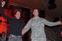 Richard Patrick (left), lead vocalist for the band Filter, and former band mate turned Army Reserve Sgt. Frank Cavanagh share the stage for a reunion song during the Operation MySpace concert at Camp Buehring, Kuwait, on March 10, 2008. Defense Dept. photos by Samantha L. Quigley