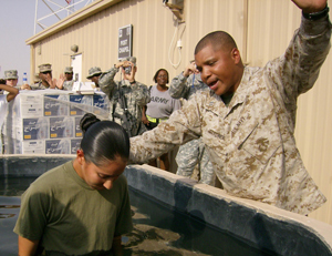 MARINE COPRS BASE CAMP LEJEUNE, N.C. (March 11, 2008) – Navy chaplain Calvin B. Gardner performs his first baptism as a Navy Chaplain in Kuwait, during November 2007, while deployed with the 22nd Marine Expeditionary Unit. Gardner served as a supply Marine for twenty-one years before entering the Navy as a chaplain. Gardner now serves as a chaplain with Combat Logistics Battalion-22, 2nd Marine Logistics Group.