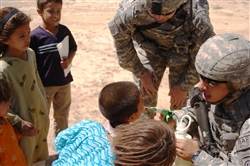 Army Staff Sgt. Joseph Peer, an 82nd Airborne Division Special Troops Battalion medic from Glendale, Ariz., deworms an Afghan child during a medical outreach event in a village near Bagram Air Base, Afghanistan, July 14, 2007. Peer is credited with saving the lives of two Afghan soldiers who were wounded in Kapisa province in August. Photo by Senior Airman Delia DeGrego, USAF