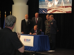 Robert Nardelli, chairman and chief executive officer of Chrysler, signs a 5-Star Military Support Agreement on May 5, 2008, in Auburn Hills, Mich., pledging the automaker's commitment to continue supporting employees who are called into active military service. Defense Department photo by John J. Kruzel