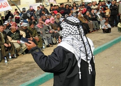A sheik addresses displaced Iraqi families returning to their homes, appealing for adherence to the local reconciliation agreement, during a ceremony welcoming families back to Baghdad's Aamel neighborhood, Feb. 9, 2008. U.S. Army photo